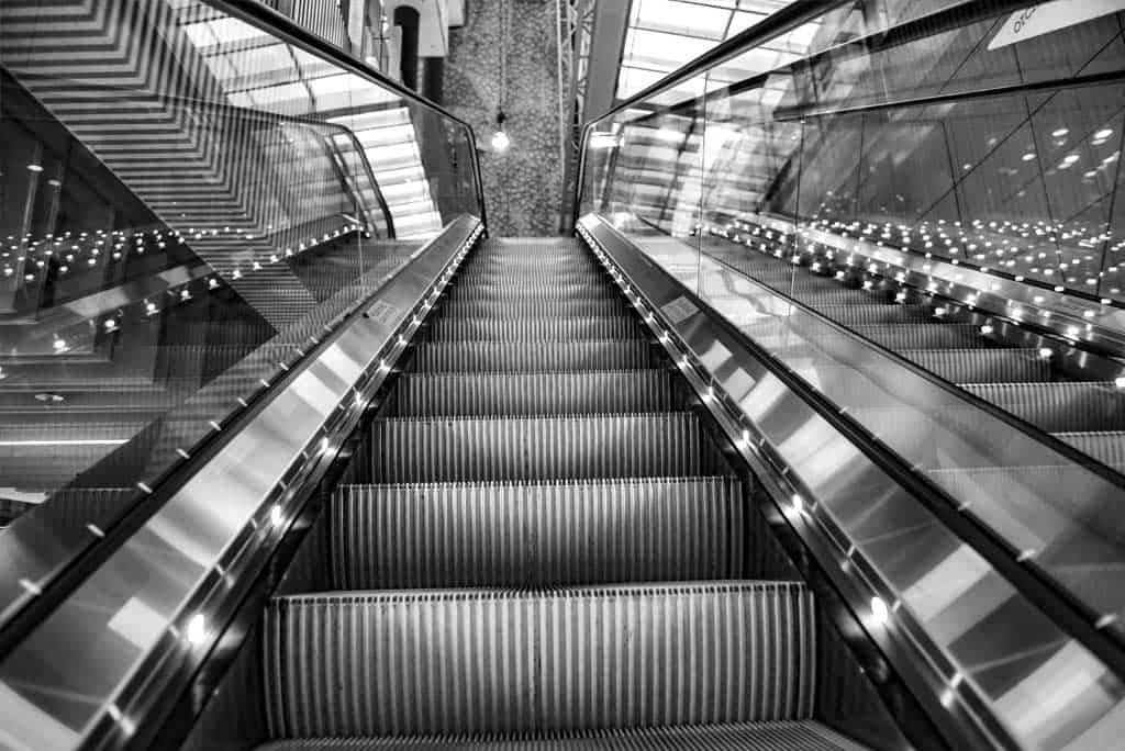 Close up of Escalator going up in black and white